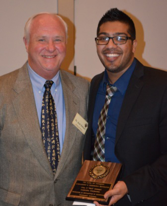 "Jack Schlegel, presented the 2013 winner of the John F. ""Jack"" Schlegel Leadership endowed Scholarship, to PDC Alpha Psi brother Clintan Shah"