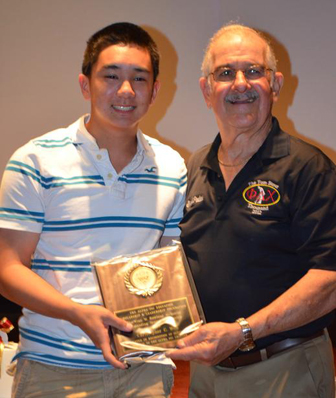 Christopher Won accepts the Ivan W. Rowland Memorial Outstanding Senior Scholarship, also presented by Ralph.