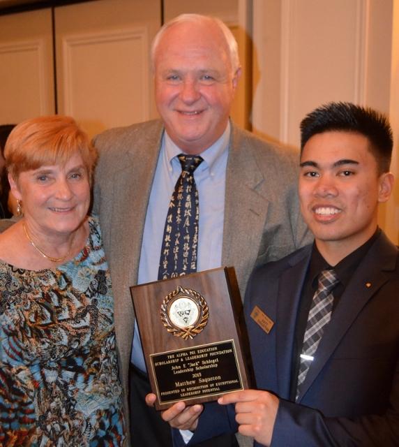 "Jack and Priscilla Schlegel presenting the winner of the 2015 John F ""Jack"" Schlegel Endowed Scholarship to PDC Alpha Psi brother Matt Saqueton"