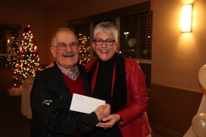 Ralph Saroyan accepting award from Linda Philipp for Alpha Psi Foundation at Community Foundation of San Joaquin Super Bowl raffle