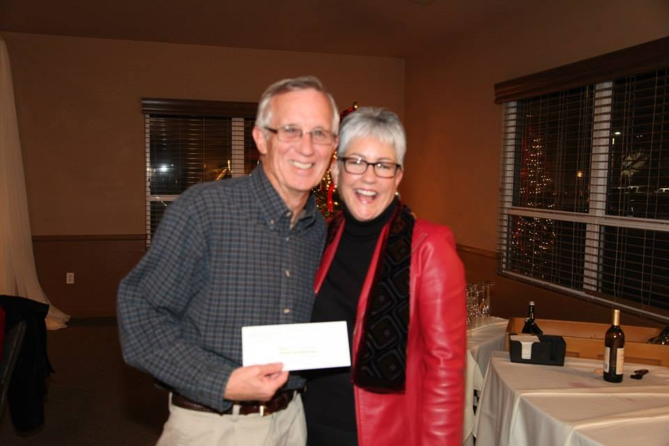 Ed Larimer accepting award at Community Foundaton of San Joaquin Super Bowl raffle on 12-2013