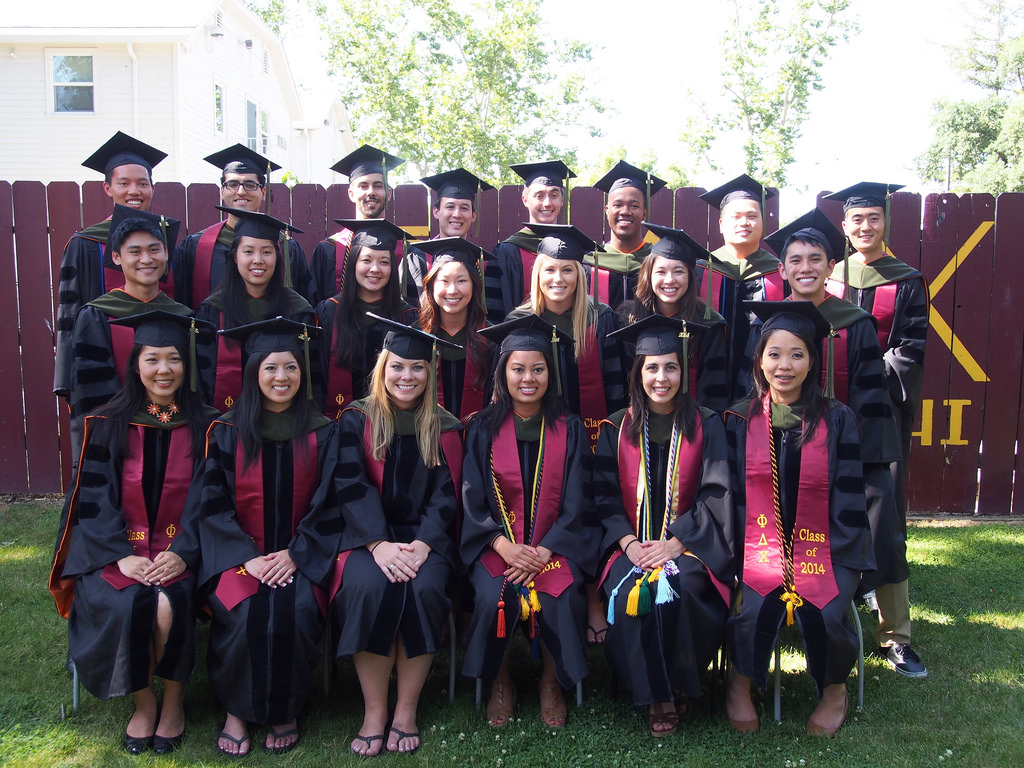 The 2014 Graduates in   Cap and Gown, our newest alumni members