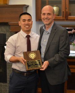 Matt Saqueton, 2015 recipient of the Ivan Rowland Memorial Outstanding Senior Scholarship, presented by Gary DeGuire, Awards Chairman