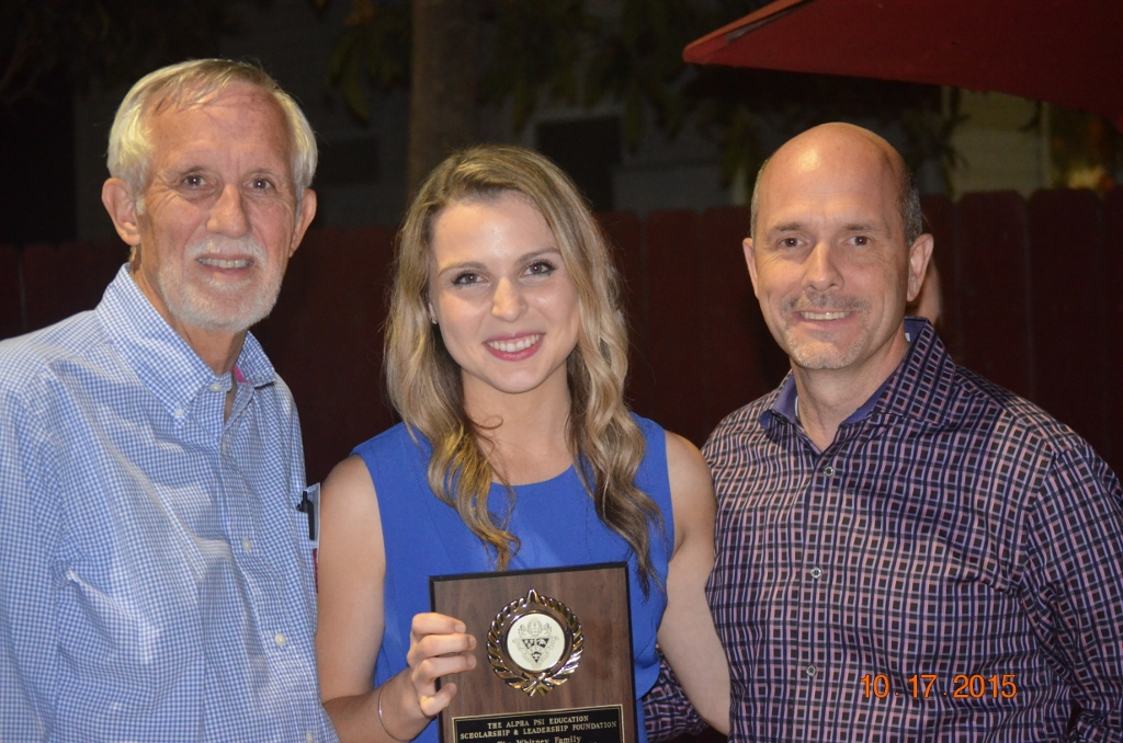 Katelyn Fischer, 2015 Whitney Family Endowed Scholarship winner, presented by Gary DeGuire (Awards Chairman) and  Ed Larimer ( Board of Directors).  Scholarship was awarded at the Alumni Homecoming Event held at the              Alpha Psi Chapter House
