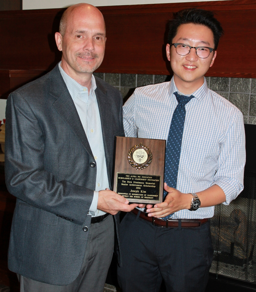 Joseph Kim, 2016 recipient of the Rick Friedmann Memorial Scholarship, presented by Gary DeGuire, Awards Chairman