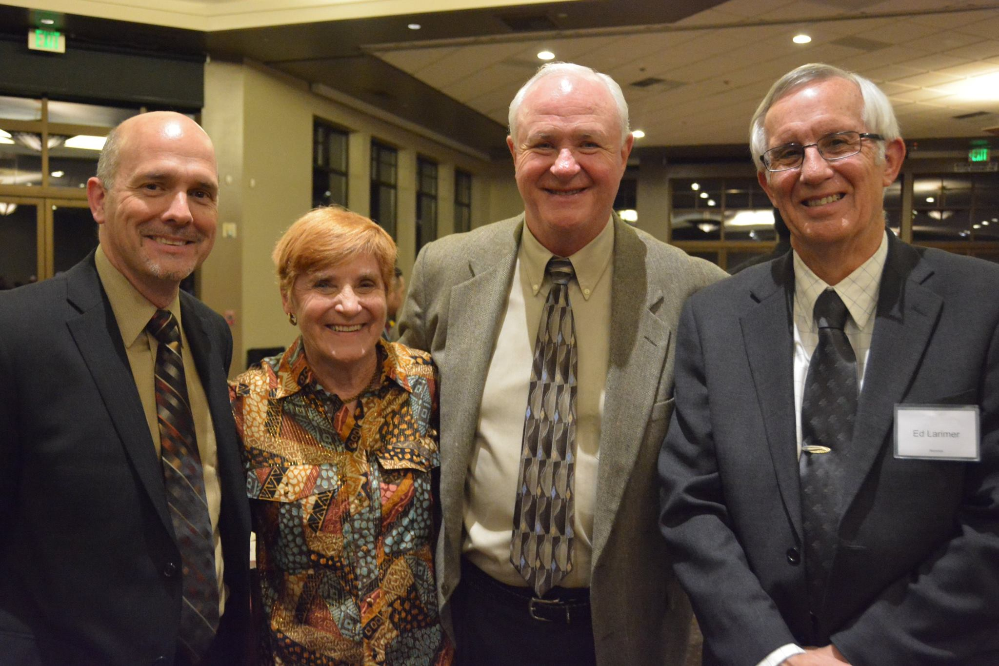 Board directors Gary DeGuire, Jack Schelgel, and Ed Larimer (L to R) with Priscilla Schlegel (2nd to left)