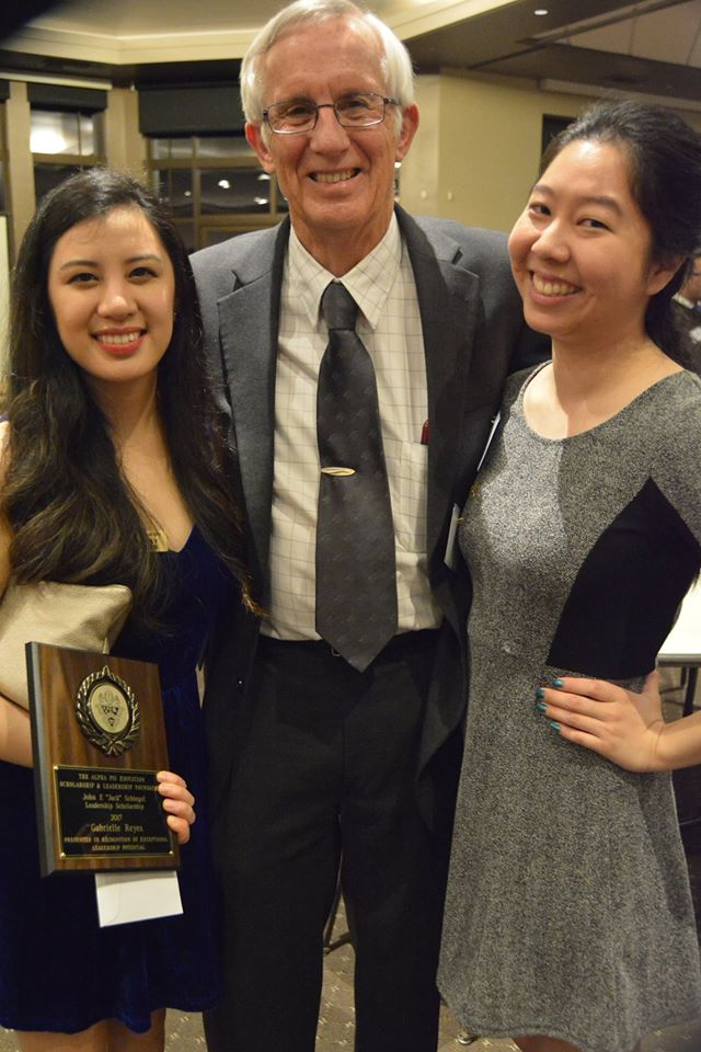Brother Gabrielle (Gabby) Reyes poses with her award and Directors Ed Larimer and Vivian Lee